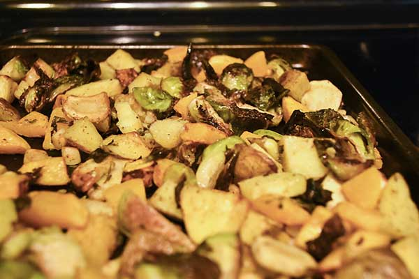 vegetables being roasted on a pan